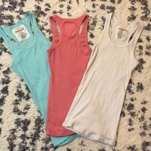 Pack of 3 tank tops. Some small